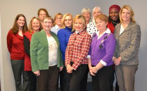 Back row (left to right): Jessica Powell - Communications Chair; Barbara Aycock, Community Outreach Co-Chair; Rebecca Saunders - Allocations Chair; Mary Hutchens - Secretary; Rebecca Moore - HCWF Coordinator; Alice Salthouse - Member At-Large; Marion Edwards - Donor Development Chair; Gillian Baker - Member At-Large. Front row (left to right): Judy Goodwin-Rosenberg - Treasurer; Mary Painter - Vice Chair/Development; Grace Will - Chair; Linda Slade - UW Executive Director