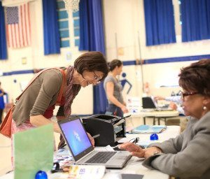 Leslie Shaw checks in at Isaac Dickson Elementary in Asheville to vote in the May 6, 2014, primary election. Colby Rabon/Carolina Public Press
