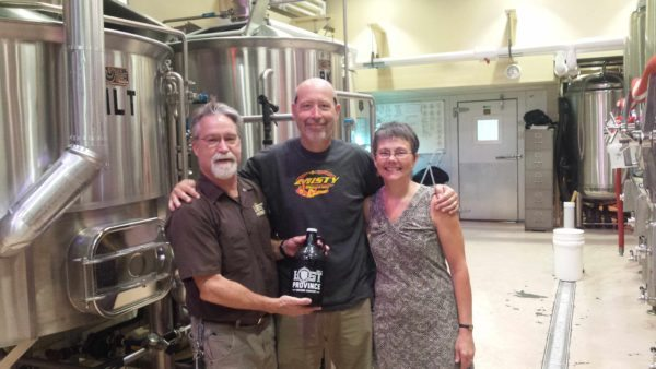 Lost Province owners Andy and Lynne Mason flank Don Cox, the owner of Bald Guy Brew