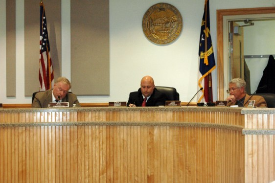 Commissioner Perry Yates, Chair Nathan Miller and Commissioner David Blust (left to right) listen to Boone Mayor Andy Ball speak. Photo by Jesse Wood