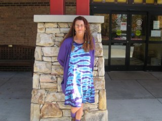 Evelyn Johnson stands in front of the Watauga County Public Library, where she worked for more than 36 years. Her favorite color was purple.