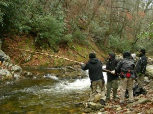 "The ""Hillbilly Blood"" film crew passes gear over a river, season one of ""Hillbilly Blood."""