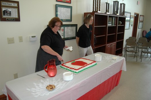 Michelle Brewer, an AppalCART trainer, cuts the cake. Photo by Jesse Wood