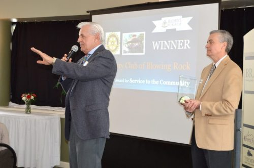 Basil Kuzyzsyn accepts the chamber's award for service to the community on behalf of the Rotary Club.
