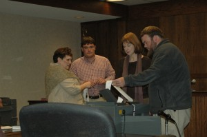 Elections Director Jane Ann Hodges (left) and Board Members Bill Aceto, Kathleen Campbell and Luke Eggers review provisional results during canvass on Tuesday. Photo by Jesse Wood