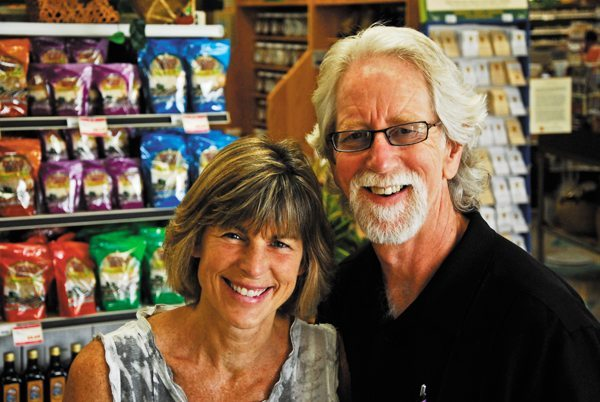 Mary Underwood and Ben Henderson are pictured at Bare Essentials Natural Market in Boone. Photo by Peter Morris for High Country Magazine.