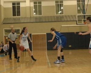 Hannah Margolis brings the ball up the court earlier this season.