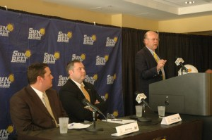 Sun Belt Commissioner Karl Benson speaks as ASU Athletics Spokesman Mike Flynn and ASU AD Charlie Cobb look on. Photo by Jesse Wood