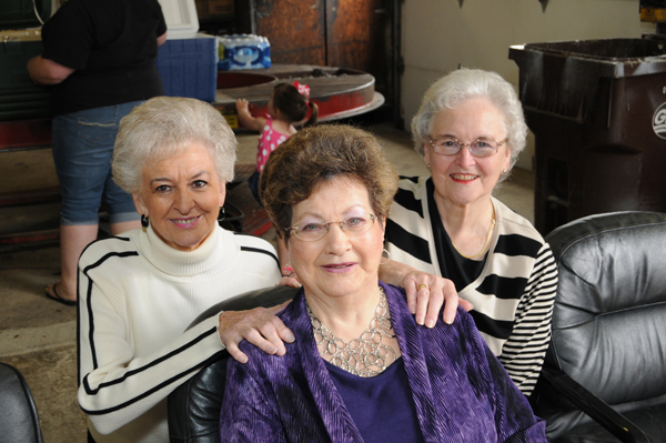 Joyce (center) with her sister-in-laws Juella H. Francis (left) and Muriel Jean Jones behind her.