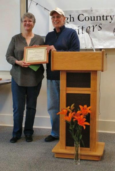 Danielle Bussone receives her Book of the Year award from Bill Runyon. Photo by Ree Strawsman.