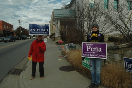 Two women hold signs for Andy Ball for Mayor and Jennifer Pena or Boone Town Council. Photo by Jesse Wood