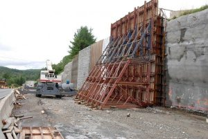 Concrete for the retaining wall cures in the rubber membrane mold. This photo was taken in 2013. Photo by Ken Ketchie