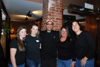 Waitstaff and co-owners Olga Esterson and Joanna Sahm flank new executive chef Joe Turner.