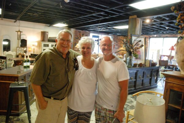 Local leader Dan Meyer and his wife stop by to do some shopping at Curiosity and are pictured with store owner David Gindlesperger.