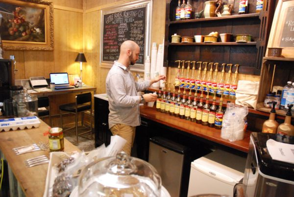 Steven Zimmerman serves up specialty coffee drinks at Curiosity's in-house coffee bar.