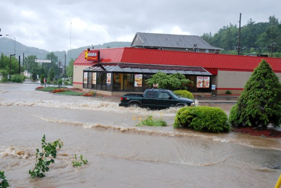 Hardee's parking lot in Boone experienced flooding on Sunday. Photo by Ken Ketchie