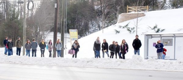 Appalachian State University students wait for the AppalCART on N.C. 105 on Monday morning. Photo by Ken Ketchie