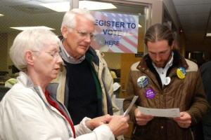Boone Mayor Loretta Clawson, who decided not to run, looks over the election results with Councilman Rennie Brantz, who was re-elected, and Quint David, who was elected. Photo by Ken Ketchie