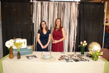 """Wedding consultants from """"The Whole Shebang"""" share ideas at the annual wedding expo in 2015."""