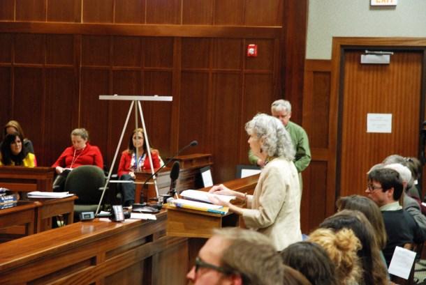 Whitaker presents before the school board.