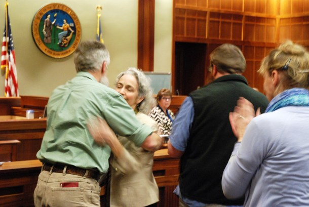 Whitaker hugs her husband after the vote.