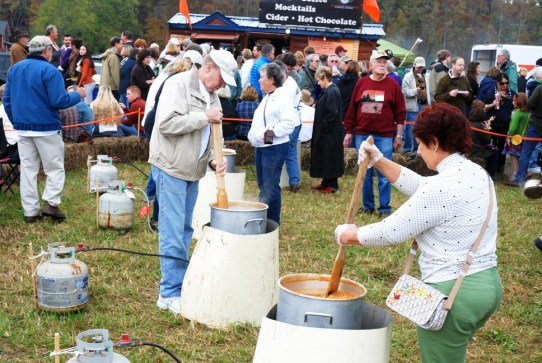 Churning fresh apple butter