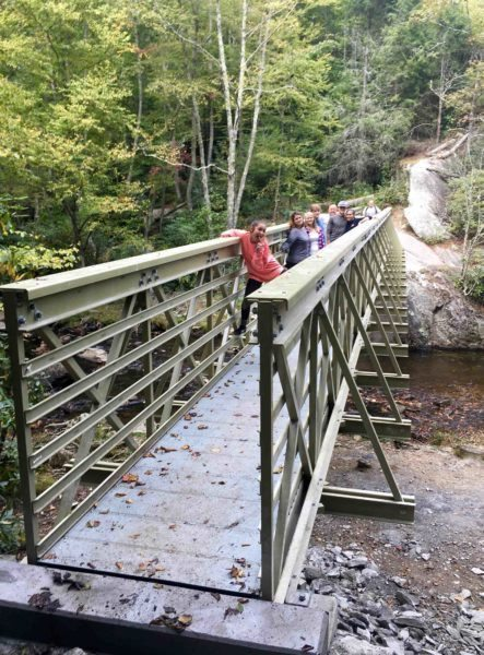This family was the first to cross the bridge on Sunday after engineer Adam Felmlee and MST volunteer Drew Koehler removed the red tape and permitted public access to great new views from above the creek. Photo by Drew Koehler