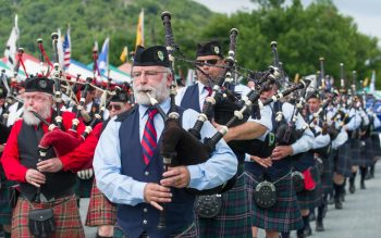 A parade of pipers circles the field at the 2014 Grandfather Mountain Highland Games. Photo by Skip Sickler.