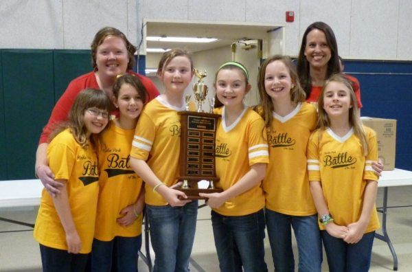 The Hardin Park Gold Team includes (students left to right) Lily Wilson, Angela Claire Henderson, Ellery Rushing, Makayla Barnes, Lydia Rothrock, and Ella Triplett. The coaches are Corrie Freeman (on left) and Emily Rothrock (at right).
