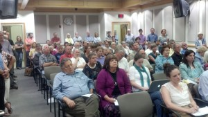 The commissioners board room was packed with people opposing the 200-acre purchase along N.C. 194. Photo by Jesse Wood