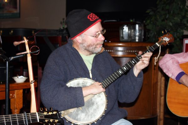 Todd banjo builder and player John Peterson, who usually begins each jam in classic bluegrass style