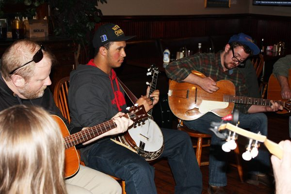 Scott Smith on guitar, Trey Wellington on banjo and Zach Smith on guitar