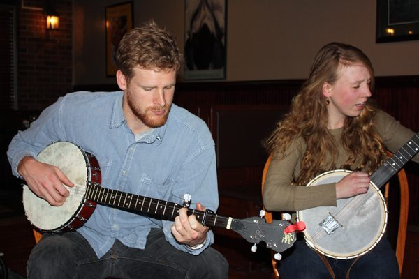 First-time jam visitor Andrew Barnes from Virginia and Lou Murrey of Boone with their open-back banjos