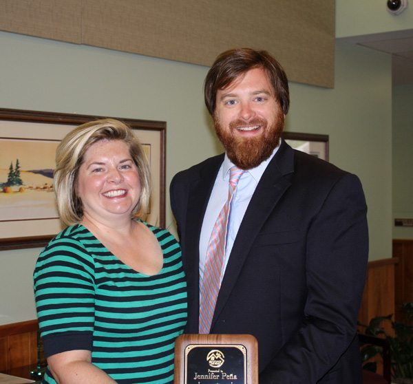 Mayor And Ball presents outgoing Council Member Jennifer Pena with a plaque of recognition.