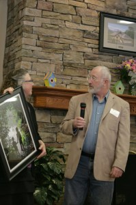 Kathy Parham presents Jim Atkinson with framed photo by Megan Long. Photo by Jennifer Spell