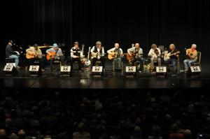 "The ""My Friend Merle"" set at MerleFest 25 featured (left to right) Jeff Little, Richard Watson, Bob Hill, David Holt, T. Michael Coleman, Doc Watson, Mitch Greenhill, Sam Bush, John Cowan and Joe Smother."