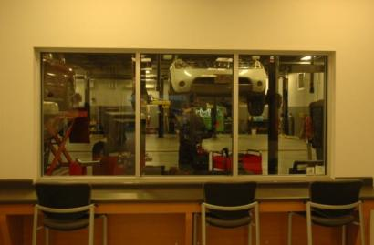 A window looking into the service area at University Nissan. Photo by Jesse Wood
