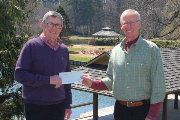 The presentation of the check by club Treasurer Bill Leahey to club President John Marshall Monday.