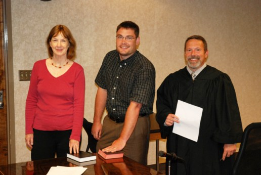 New members of the Watauga County Board of Elections Kathleen Campbell, a Democrat, and Bill Aceto, a Republican, were sworn in by Judge Ted McEntire on Tuesday. Photo by Jesse Wood