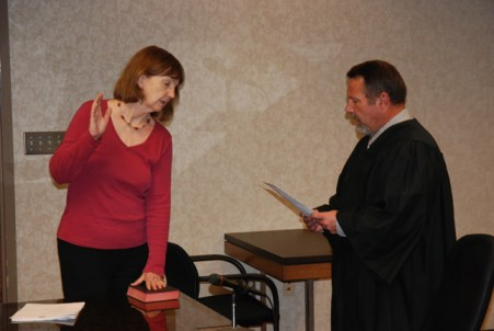 Judge Ted McEntire swears in Kathleen Campbell. Photo by Jesse Wood