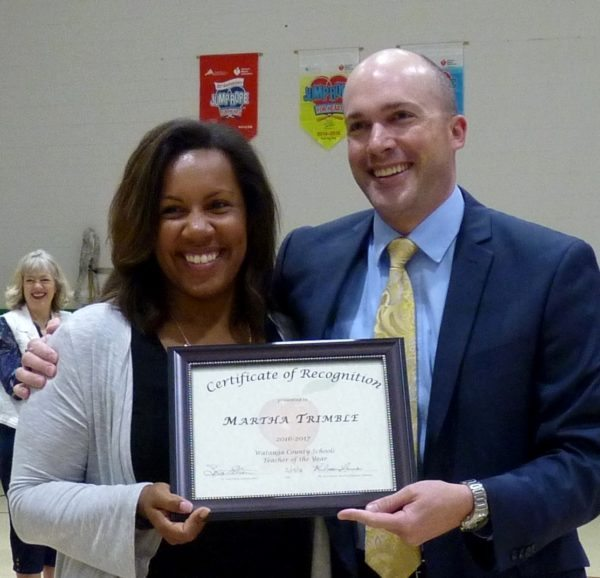 Martha Trimble and Dr. Scott Elliott (during Trimble's May 13 recognition as WCS Teacher of the Year)