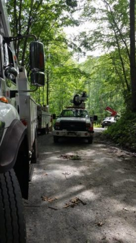 Trucks and linemen working final resoration efforts