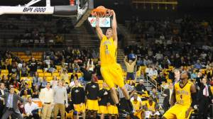 Nate Healy throws down a slam dunk to put an exclamation mark on Appalachian State's 74-65 win over archrival Western Carolina on Saturday afternoon at the Holmes Center. Photo by Dave Mayo | ASU Sports