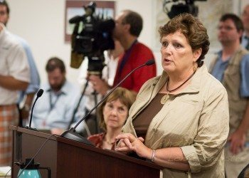 Watauga Elections Director Jane Ann Hodges speaks before the State Board of Elections in 2013. Photos by Lonnie Webster
