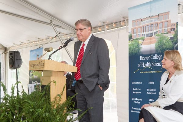 Donald C. Beaver, namesake of the Beaver College of Health Sciences, speaks during the groundbreaking ceremony as Chancellor Sheri N. Everts looks on.