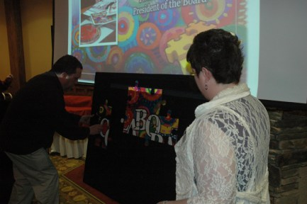 attendees used their table's puzzle pieces to complete an image