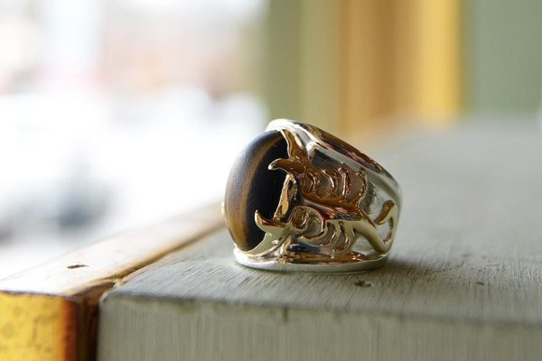 OWG's Morgan Shaw revitalized this men's tiger's eye ring, restoring its intricate details and breathing life back into this family heirloom for the client. Photo courtesy of Old World Galleries.