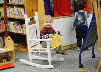 A little reader enjoys daily story time at the Watauga County Public Library.
