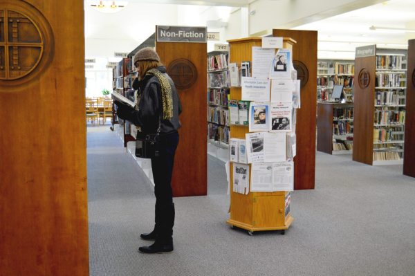 An interested reader explores the shelves at the Watauga Library.