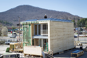 Appalachian State University's entry in Solar Decathlon Europe 2014 is a two-bedroom, two-bath row dwelling. Its energy efficient features include rooftop solar panels, an energy-efficient building exterior and an integrated plumbing, mechanical and electrical system. Photo by Marie Freeman